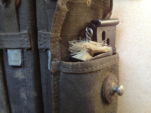Magazine brush and Magazine loader stored in magazine pouch
